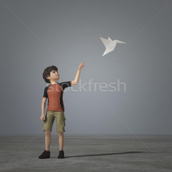 Pequeño nino jugando avión de papel origami 3d Foto stock © orla
