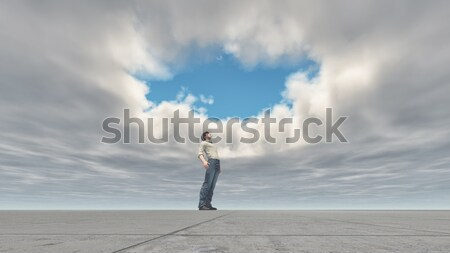 Man standing looking at the sky Stock photo © orla