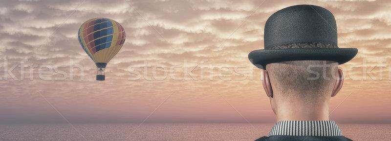 Man looks at hot air balloons Stock photo © orla
