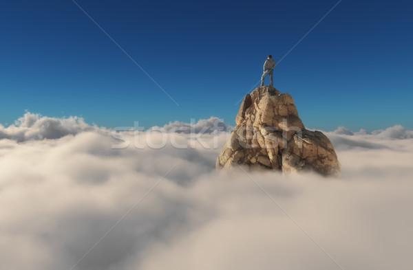 Adam ayakta taş uçurum bulutlar başarı Stok fotoğraf © orla
