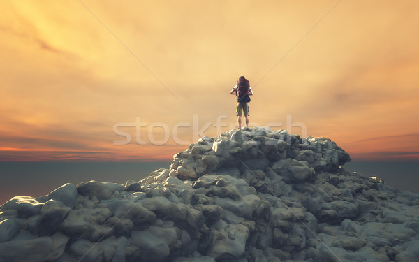 Man with backpack on a rock  Stock photo © orla