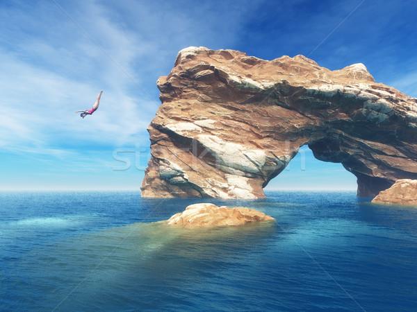 Vrouw springen af klif oceaan ruw Stockfoto © orla