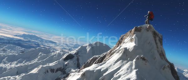 Climber on a snowy peak  Stock photo © orla