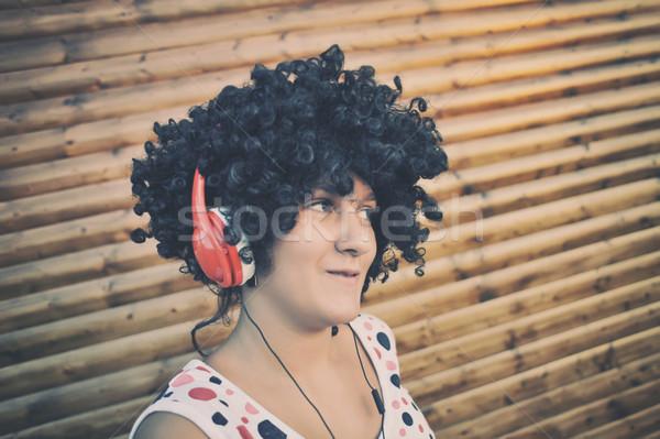 Girl listening to music on headphones Stock photo © orla