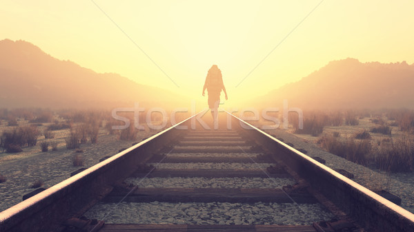 Young man walking on railroad Stock photo © orla
