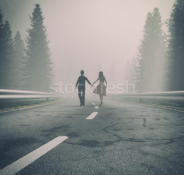 пару ходьбе стороны лес дороги туманный Сток-фото © orla