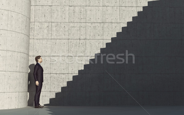 Young man in front of stairs  Stock photo © orla