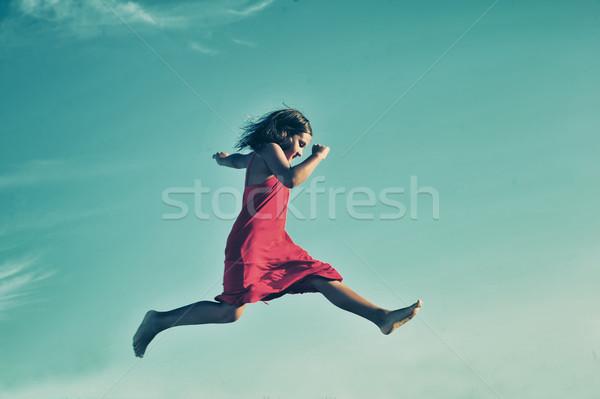 Girl jumping Stock photo © orla