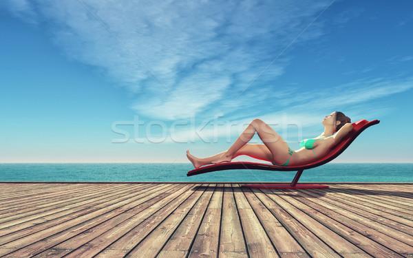 Jonge vrouw ontspannen badpak zonnebank houten pier Stockfoto © orla