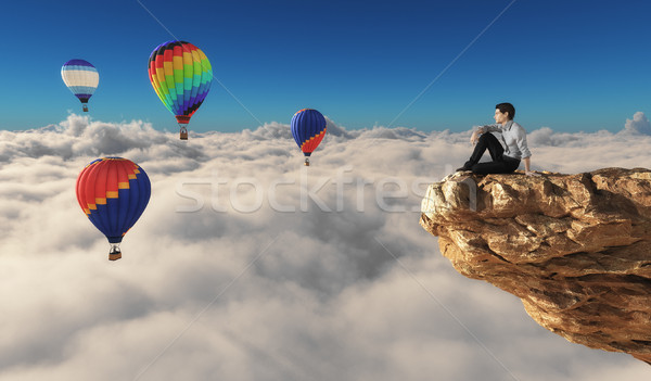 Man sits on a rock  Stock photo © orla