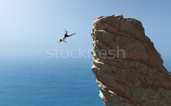 Man jumps into the ocean  Stock photo © orla