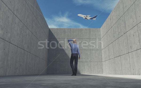 Young man looking over wall  Stock photo © orla