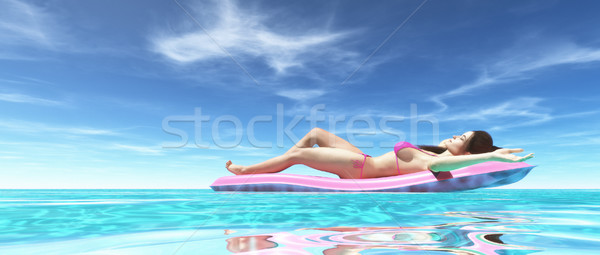 Happy woman on pink air bed Stock photo © orla