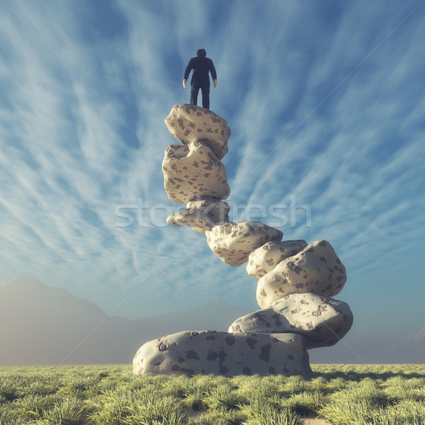 Silhouette of a man on top of rocks  Stock photo © orla