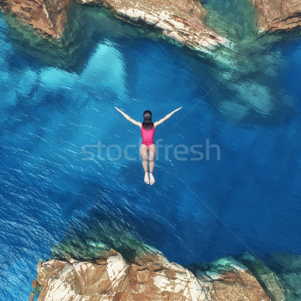Woman jumping off cliff  Stock photo © orla