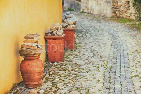 Decorative pottery on a cobblestone street Stock photo © orla