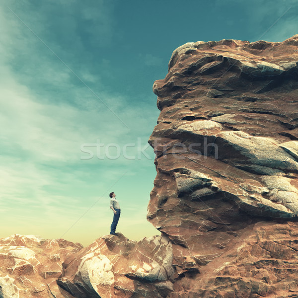 Stock photo: Young man standing on edge