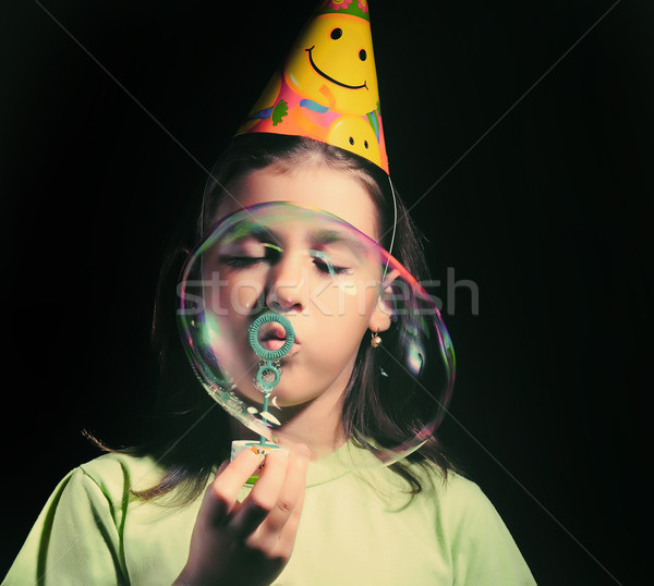 Little girl blowing soap bubbles, children birthday party  Stock photo © orla