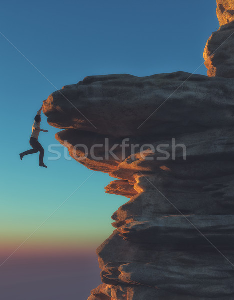 Young man hanging from a cliff Stock photo © orla