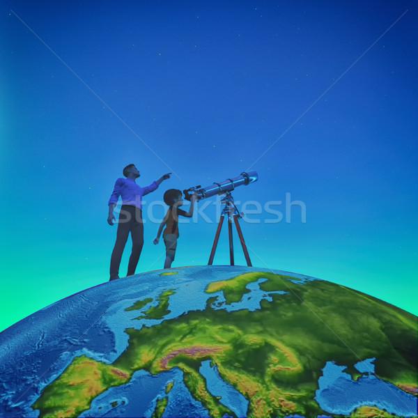 A man showed him a child telescope starry sky  Stock photo © orla