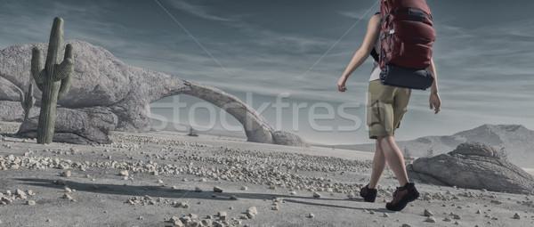 Tourist backpacking through desert.  Stock photo © orla