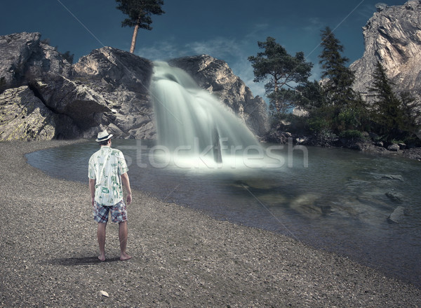 Adam çağlayan genç bakıyor göl su Stok fotoğraf © orla
