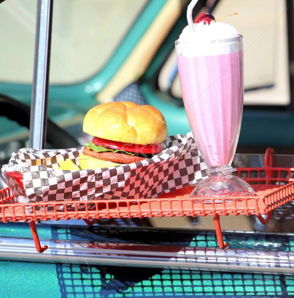 Burger ortak sürmek süt Stok fotoğraf © oscarcwilliams