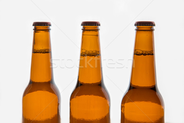 Three brown beer bottles Stock photo © ottoduplessis