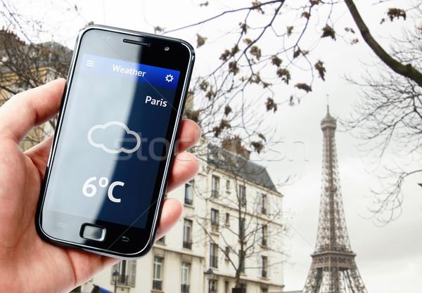 Hand smartphone weer Parijs scherm Stockfoto © pab_map