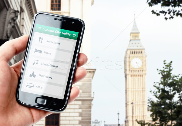 Main smartphone ville guider Londres Photo stock © pab_map