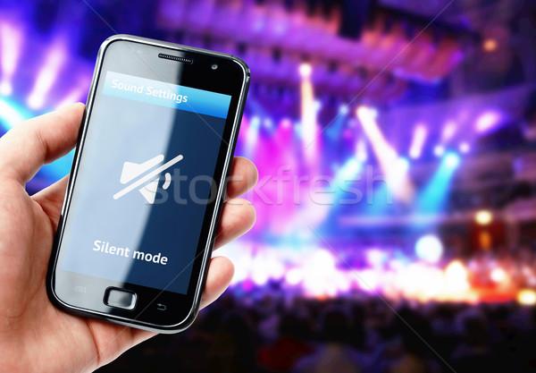 Kéz tart okostelefon néma hang koncert Stock fotó © pab_map