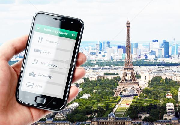 Hand smartphone stad begeleiden Parijs Stockfoto © pab_map