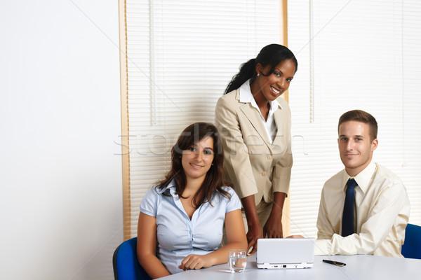 Trabalhando grupo pessoas de negócios jovem multinacional olhando Foto stock © pablocalvog