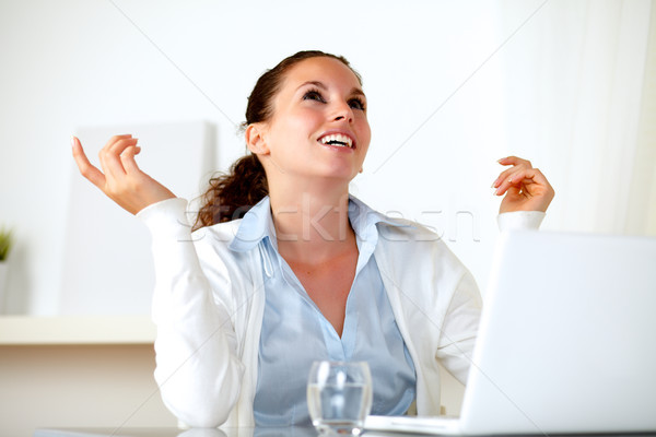 Happy young woman smiling and looking up Stock photo © pablocalvog