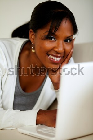 Young woman browsing the Internet on laptop Stock photo © pablocalvog