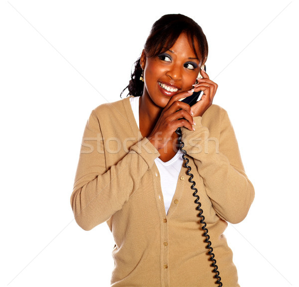 Stock photo: Ethnic young woman conversing on phone