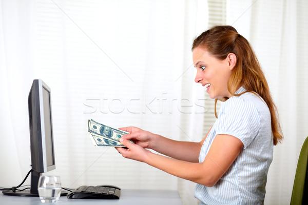 Stockfoto: Verwonderd · mooie · vrouw · naar · dollar · portret