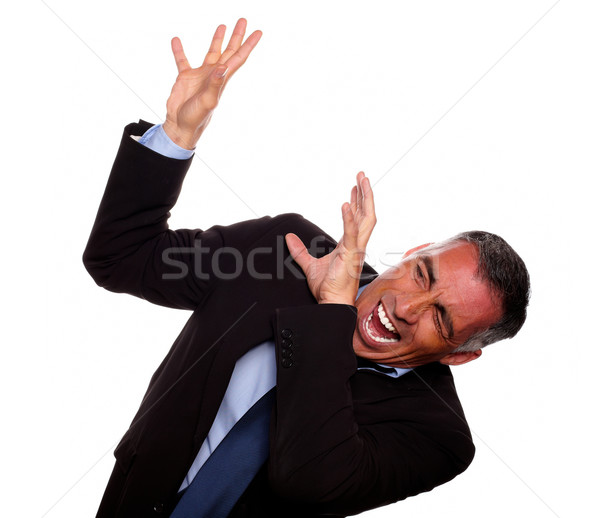 Excited executive screaming with hands up Stock photo © pablocalvog