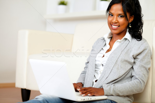 Lovely girl smiling and looking to you Stock photo © pablocalvog