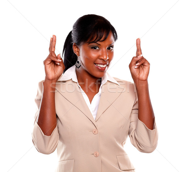 Young executive woman crossing fingers Stock photo © pablocalvog
