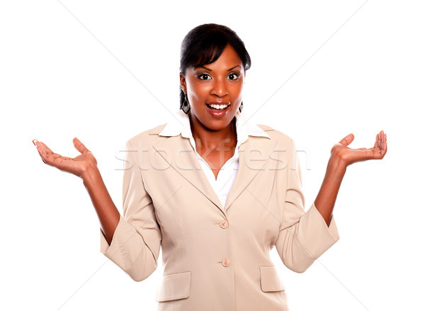 Stylish businesswoman looking at you with arms up Stock photo © pablocalvog