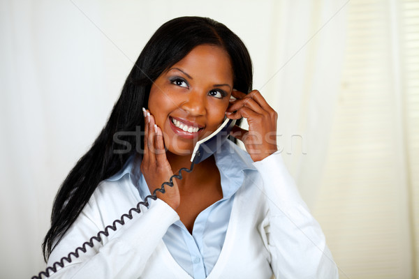 Young black lady conversing on phone Stock photo © pablocalvog