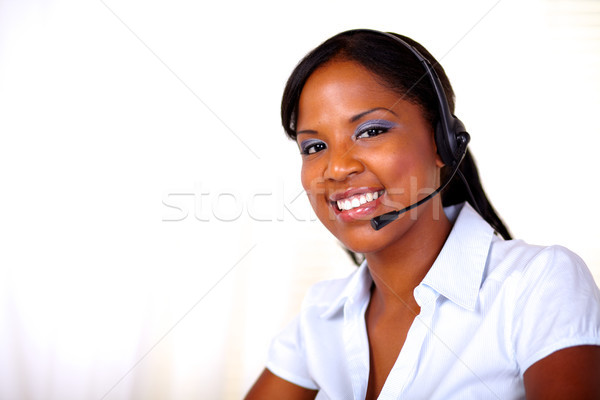Beautiful receptionist smiling and looking at you Stock photo © pablocalvog
