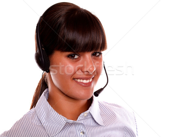Smiling receptionist using earphone looking at you Stock photo © pablocalvog