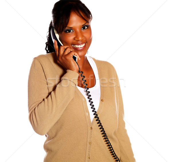 Adult woman looking at you speaking on phone Stock photo © pablocalvog