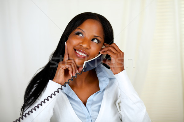 Stock photo: Young lovely woman conversing on phone