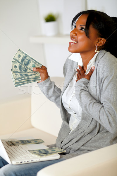 Happy woman holding plenty of cash money Stock photo © pablocalvog