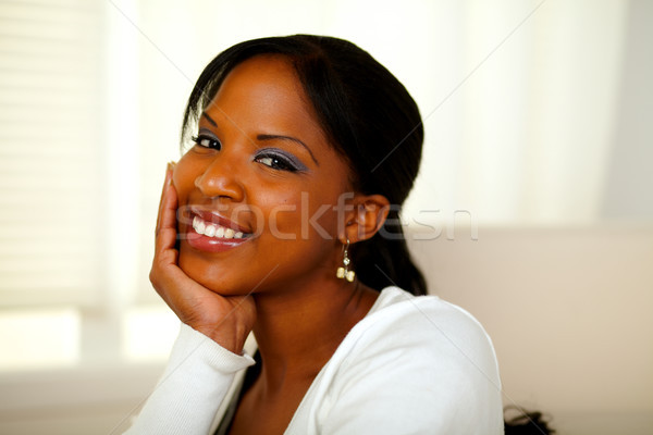 Positive afro-american pretty woman looking at you Stock photo © pablocalvog