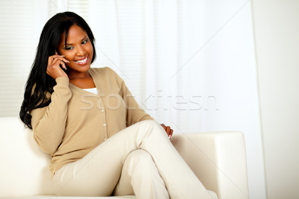 Lovely young woman smiling and conversing on phone Stock photo © pablocalvog