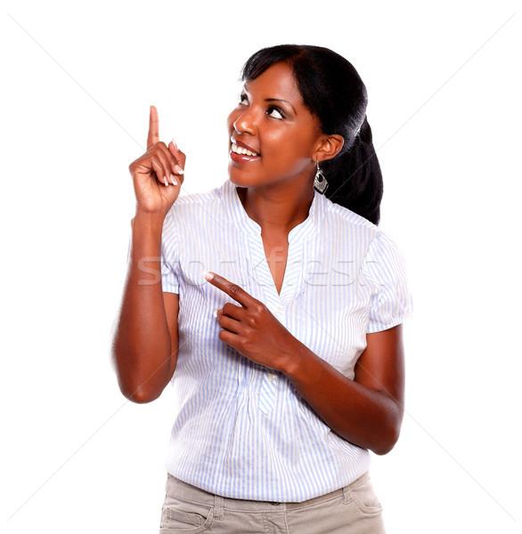 Genç kadın işaret yukarı beyaz kadın Stok fotoğraf © pablocalvog